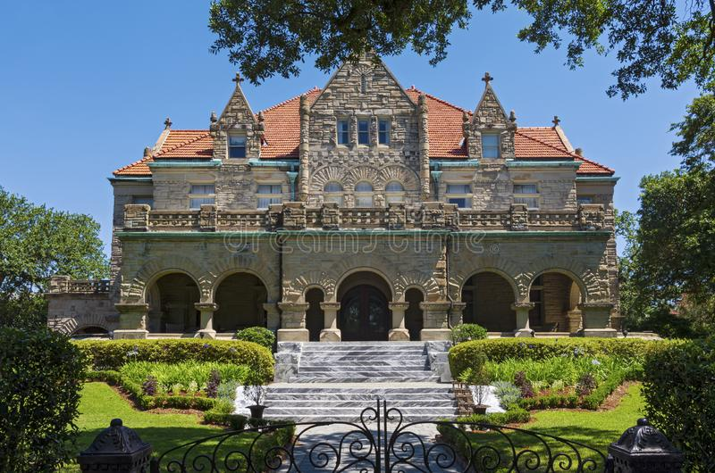 Landmark Mansion and Gardens in New Orleans. Landmark mansion of richardsonian romanesque style architecture and gardens in new orleans louisiana royalty free stock images