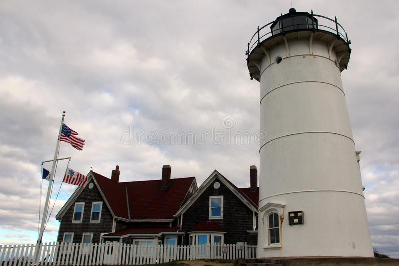 Nobska Lighthouse, Falmouth, Massachusetts, United States. The landmark Nobska Lighthouse stands at the town's southern tip. White lighthouse, red toned stock photo