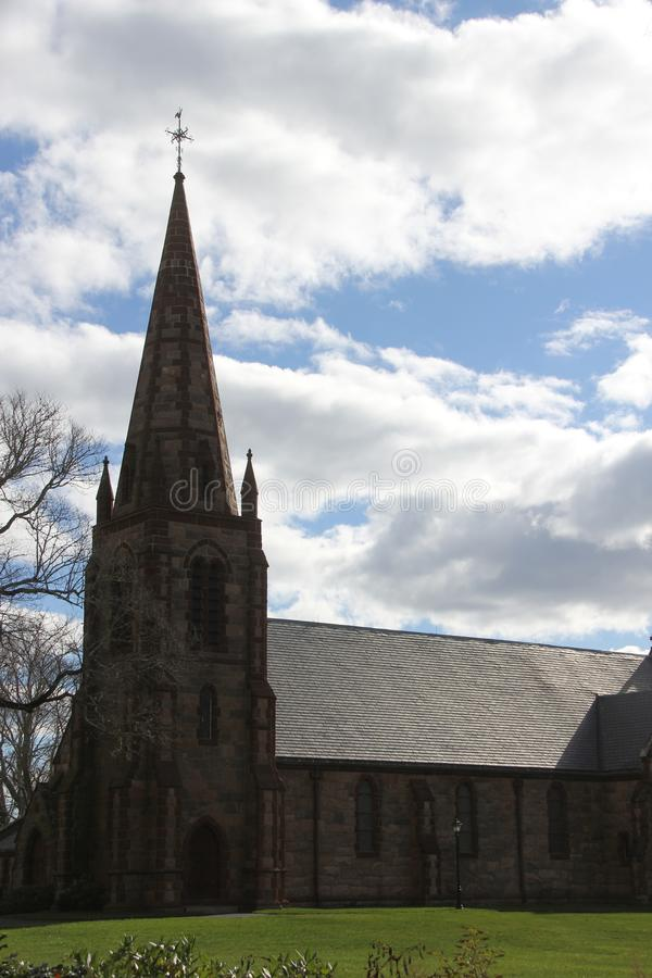 St. Barnabas Memorial Church, Falmouth, Massachusetts, United States. The landmark stone church in the scenic town of Falmouth, with tall steeple and cross on stock photography