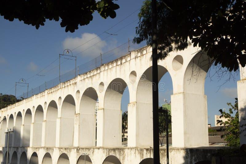 Landmark white arches of Arcos da Lapa in Centro of Rio de Janeiro Brazil. South travel architecture outdoors day city horizontal famous santa latin stock photo