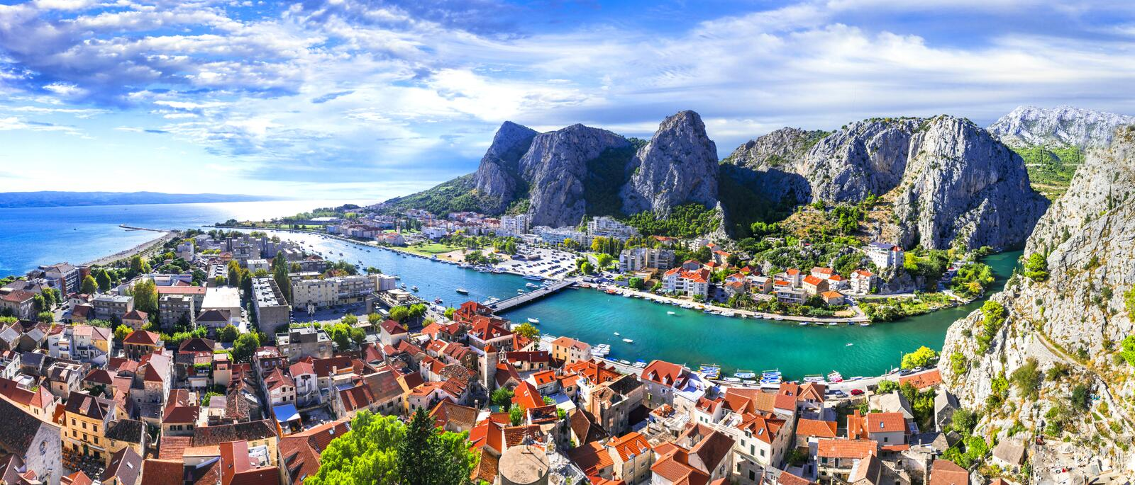 Travel in Croatia - Omis town surrounded by mountains royalty free stock photography