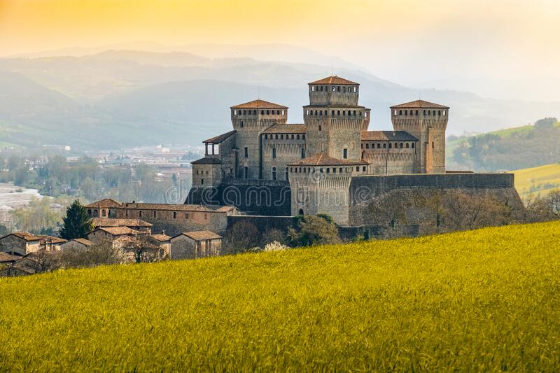 Landmarks of italy, the Torrechiara fantasy castle near Parma - Italy with yellow warm toned grass and sky vintage look royalty free stock photography