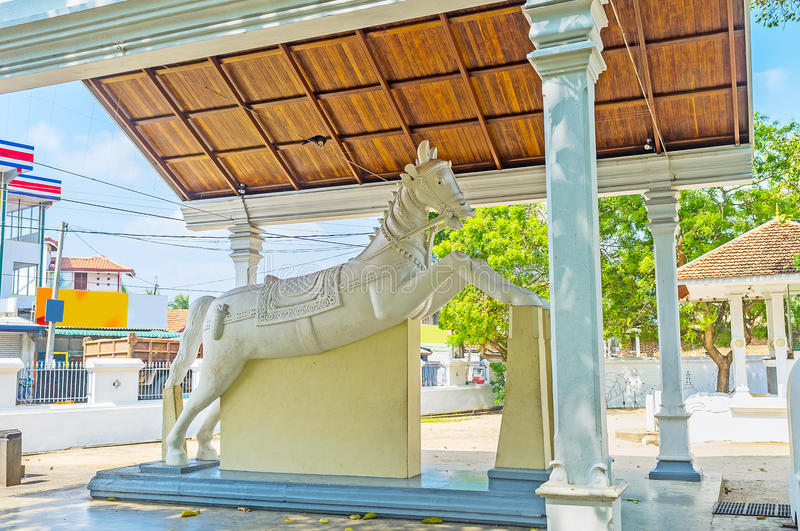 The landmarks of Madampe. Thaniwalla Devalaya Temple located by the road to Chilaw and many travelers visit it due to the unusual white horse statue, standing in royalty free stock image