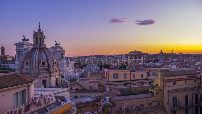 Beautiful view of Rome in the evening and the sights from the roof of the historic building royalty free stock photo