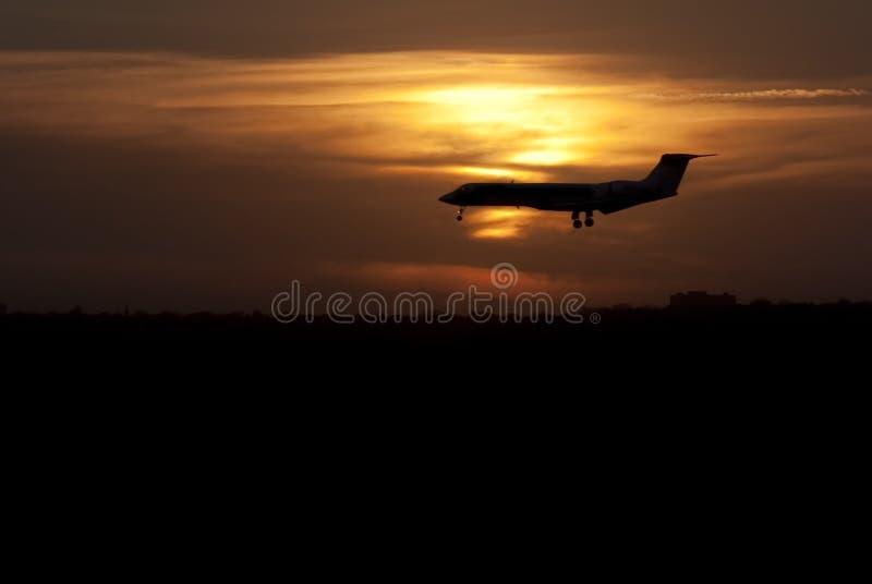 landningnivåsolnedgång arkivfoton