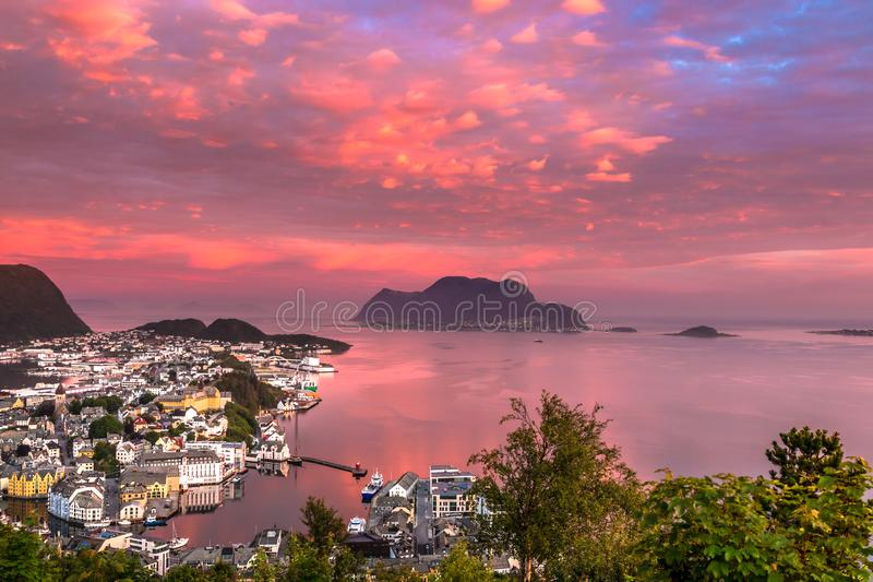 Landscape with Aerial View of Alesund Center and Atlantic Ocean at Beautiful Sunrise. Image of Alesund at glorius sunrise in Summer taken from Mount Aksla stock photos