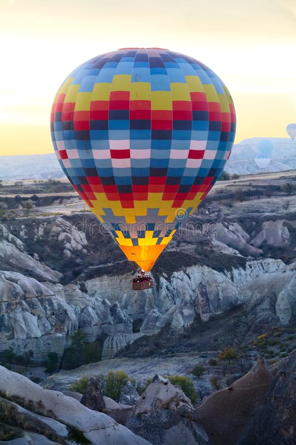 Landscape, aerostat in the air. Landscape with aerostat in the air at sunrise. Cappadocia. Turkey royalty free stock photos