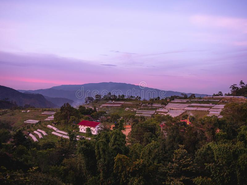 Landscape of agricultural areas of people in Fang district, Chiang Mai, Thailand from the top of the mountain in the evening on. Sunset background royalty free stock images