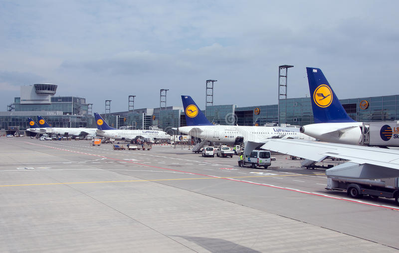 Landscape of airfield in Frankfurt, Germany. FRANKFURT, GERMANY - MAY 19: Aircrafts standing near the terminal 1 at Frankfurt/Main airport on May 19, 2013. It`s stock photos