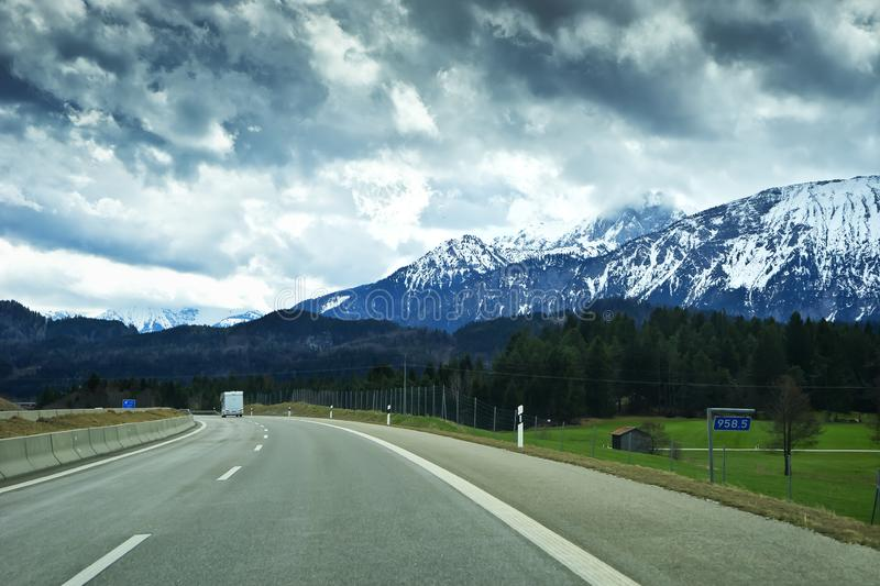 Landscape of the Alps mountains and the road to town of Fussen. Schwarzwald in the state of Baden Wurttemberg in southwest Germany stock photography