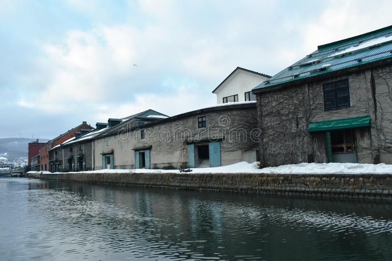 Ancient warehouse on Otaru canal old port town and landmark in Hokkaido Japan. Landscape of ancient warehouse on Otaru canal old port town and landmark in stock photography