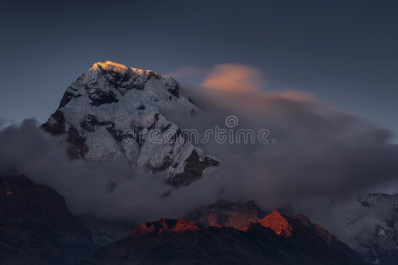 Landscape with Annapurna South peak view from Tadapani during trekking in Himalaya Mountains, Nepal stock image