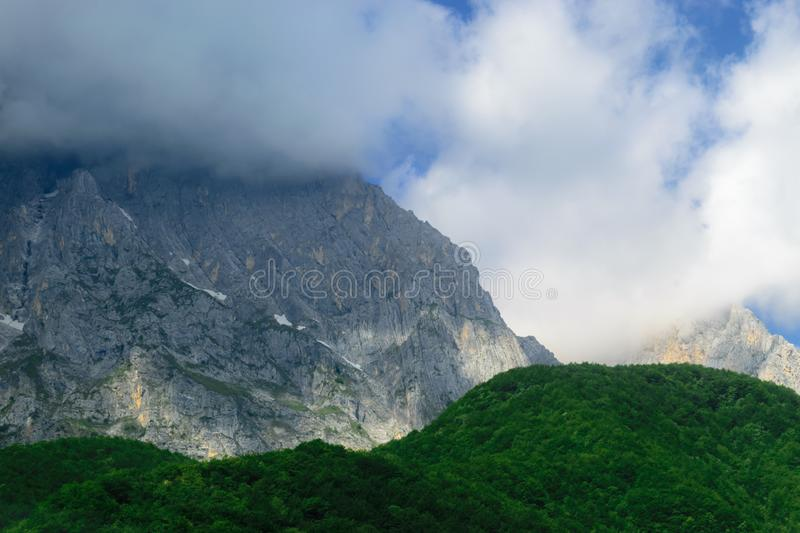 Landscape of Apennines mountains. Dense cloud covering the peak of the of Apennines mountains in the background of green woods during summer day in Italy royalty free stock photos