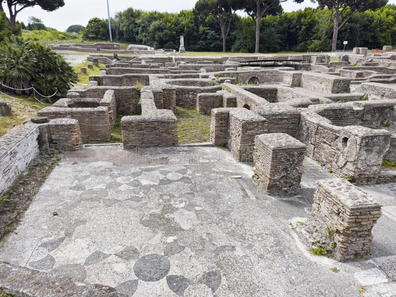 Landscape of the Apodyterium in Cisiarii thermal bath with beautiful wit mosaic flooring with geometric shape, Ostia Antica. Landscape of the Apodyterium in royalty free stock images