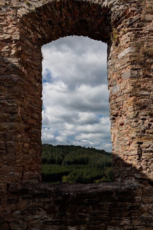 Window frame clouds landscape medieval castle Franchimont, Theux, Liege, Belgium royalty free stock image