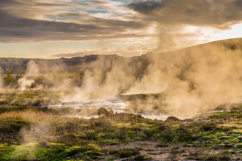 Landscape around geyser with fog patches stock images
