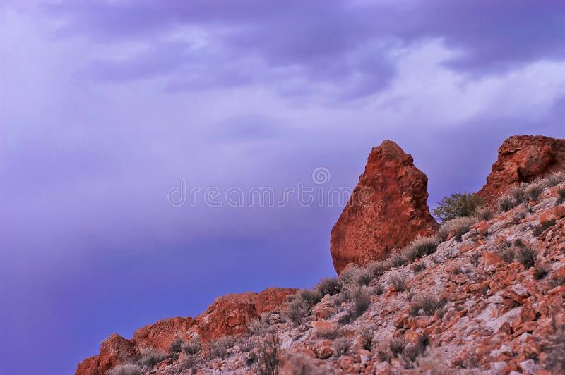 Single Large Boulder with Conical Shape Standing above all the Others. stock photo