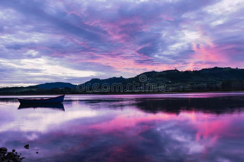 Landscape from Asturias, Spain.Reflection of Single Boat royalty free stock photography