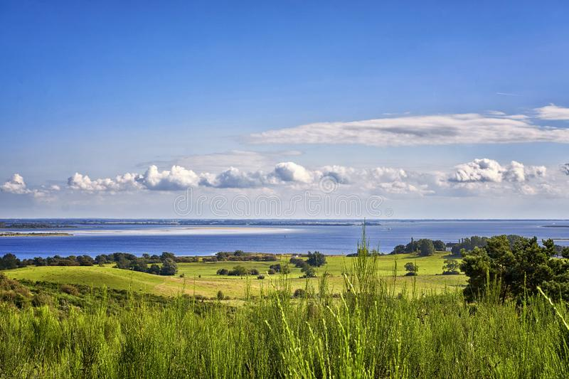 Landscape and Baltic Sea with clouds on the island Hiddensee. Panorama of Hiddensee. Meadow, nature, baltic-sea-island, mecklenburg-vorpommern, summer, ozean stock photo