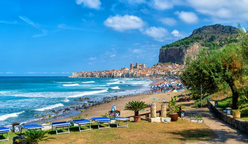 Landscape with beach and medieval Cefalu town on Sicily island, Italy stock images