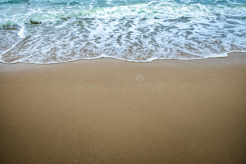 Landscape of beach and sea. Wave with sand stock image