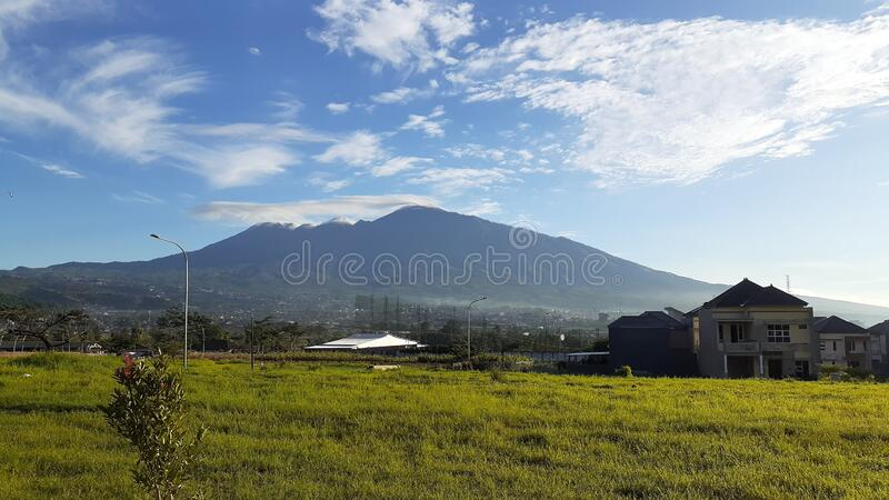 Landscape of Beautiful Mountain in Batu, Indonesia. A Landscape of Mountain in the morning in Batu, Indonesia. A perfect combinations of blue sky and green grass stock photos