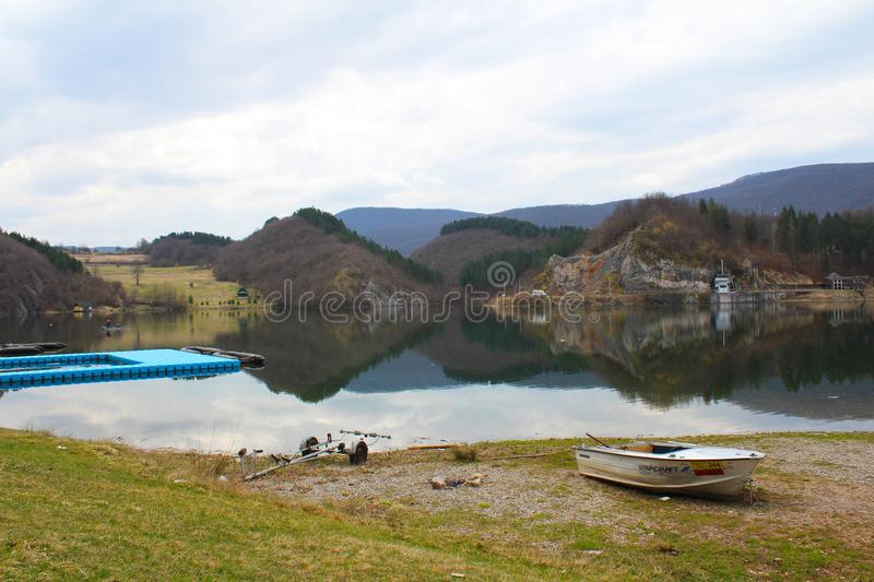 Landscape of a beautiful Radoinja lake with reflection in Serbia stock photography