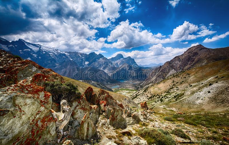 Landscape of beautiful rocky Fan mountains and Kulikalon lakes in Tajikistan. On thunderclouds sky background stock photos