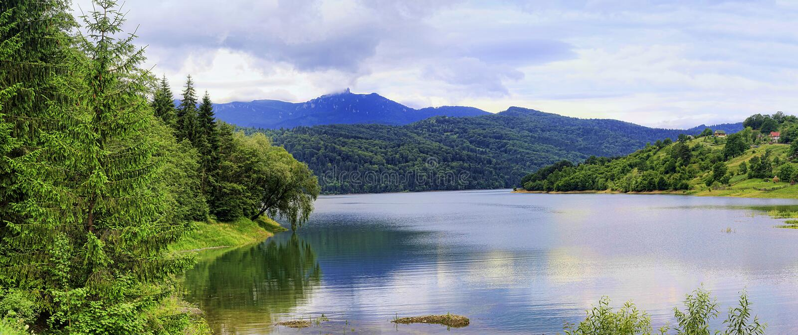 Landscape with Bicaz lake and Ceahlau mountain stock photography