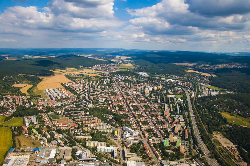 Landscape with big city in Czech republic - Brno from above surrounded by forests and hills royalty free stock photo