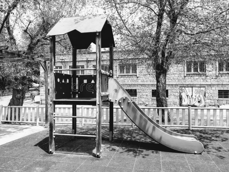 Landscape in black and white. A slide in a park. stock photos