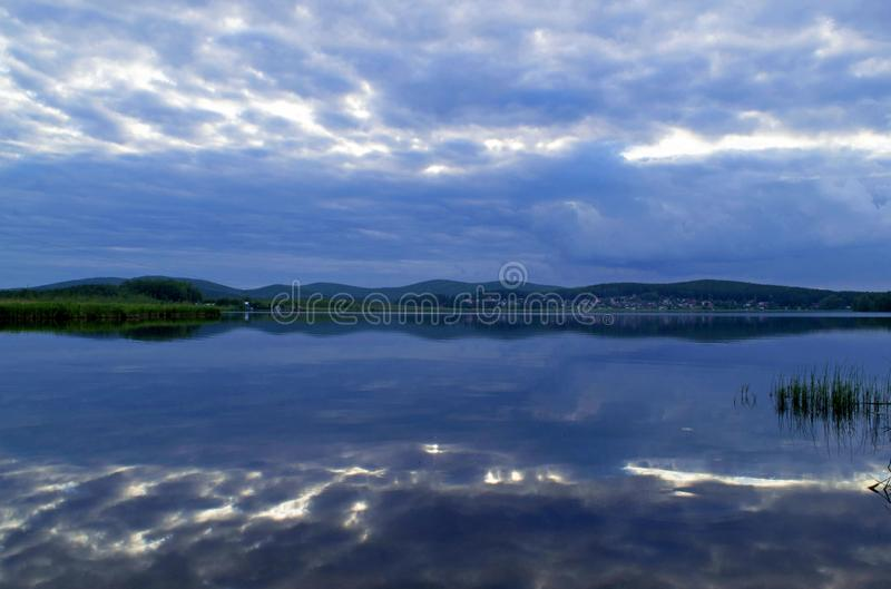 Landscape in blue. Reflection of the evening sky in the water. River Iset. Ural. Sverdlovsk region, Russia stock photo