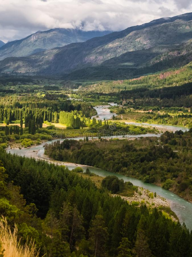 Landscape of Blue river, valley and forest in El Bolson, argentinian Patagonia.  royalty free stock images