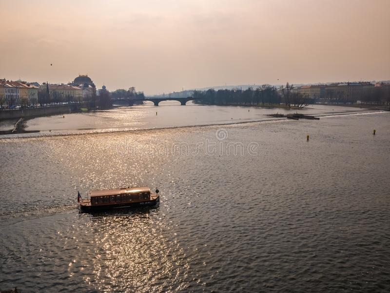 Landscape the boat view from charles bridge, Prague Czech Republic. Blue and orange sky color. royalty free stock photo