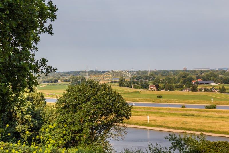 Rhine landscape Arnhem Netherlands. Landscape with a bridge over the Rhine near Arnhem in the Netherlands stock photos