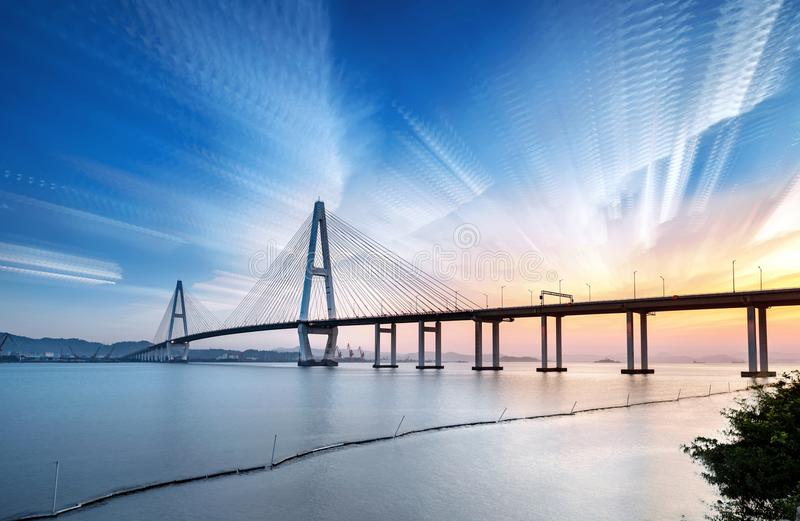 Landscape of the bridge over the sea at dusk stock photography