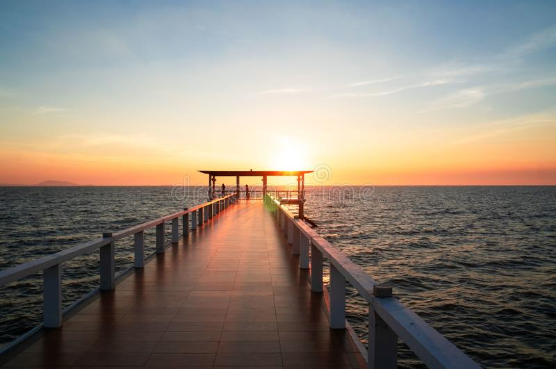Landscape of bridge in sea on tropical beach and sunset sky background.  stock photography