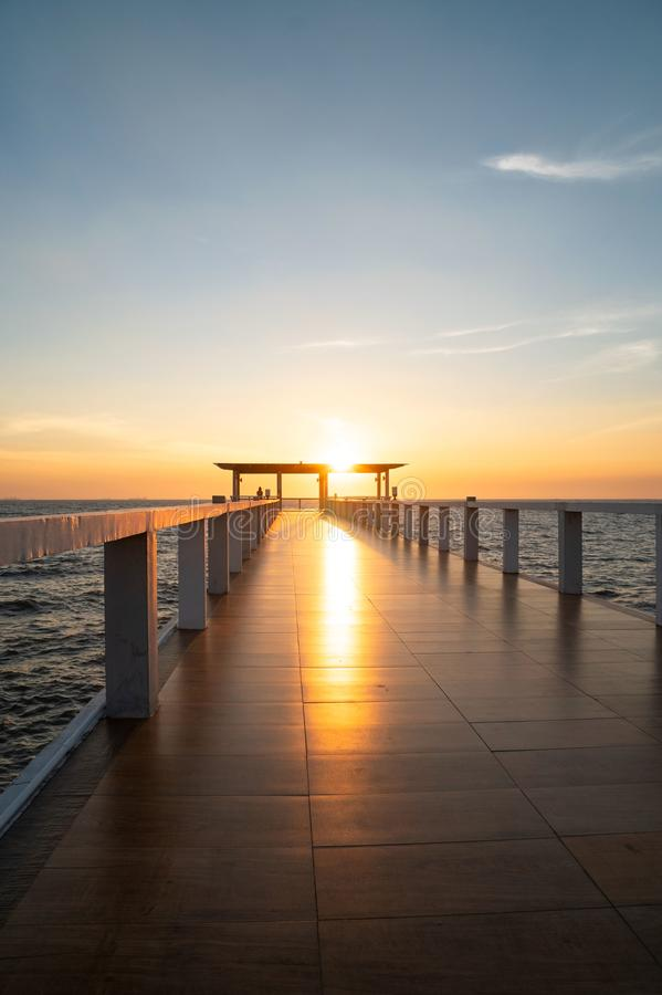Landscape of bridge in sea on tropical beach and sunset sky background.  royalty free stock photo