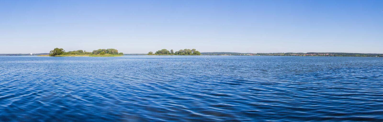 Landscape, bright day. Trees, water, bright sky stock image