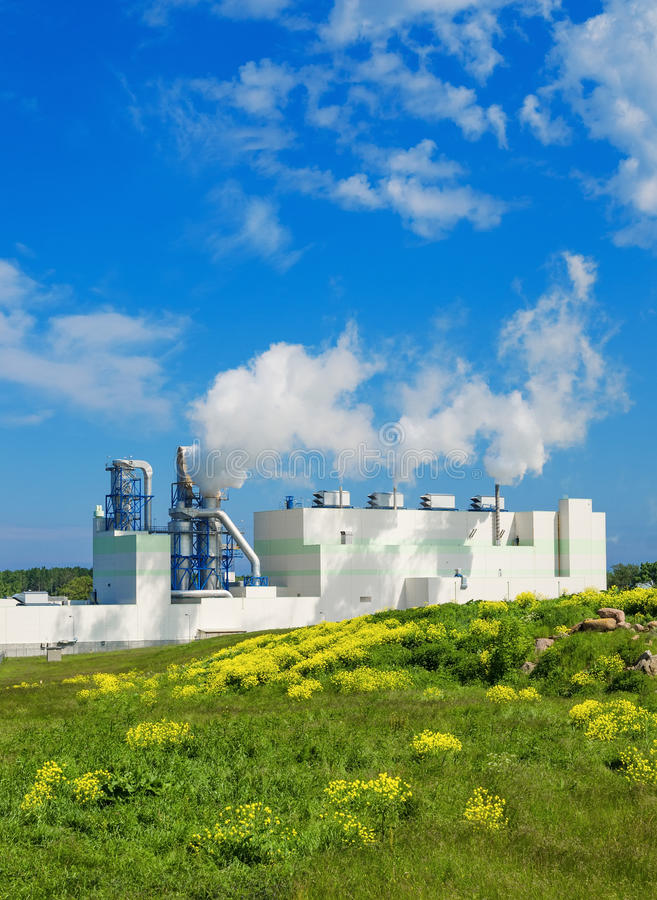 Landscape with the building of the modern environmental p. Summer landscape with the building of the modern environmental production royalty free stock images
