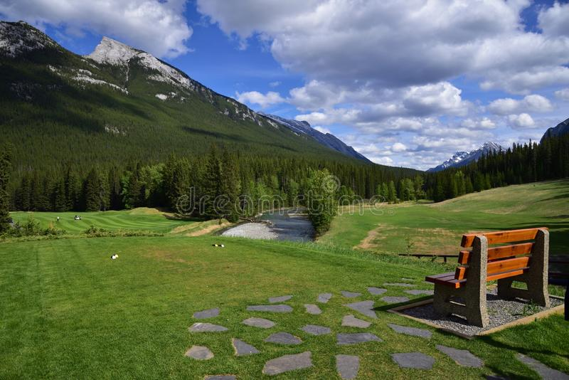 A golfing location in middle of amazing landscapes. A landscape of Canadian Rocky Mountain with a view of golf ground in Banff National Park. An ideal location royalty free stock images