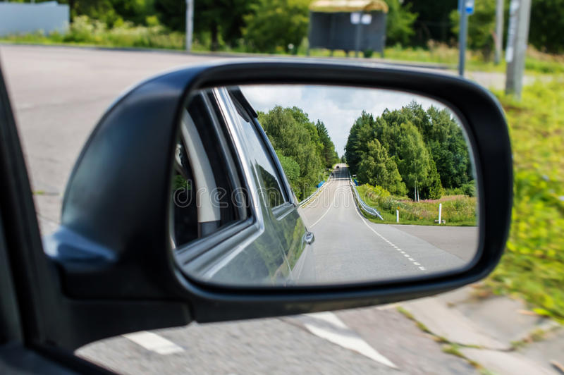 Landscape in the car mirror. Landscape reflection in the car mirror rear view stock photo