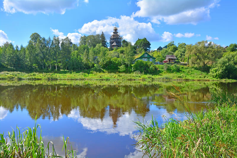 Landscape with Church of the Icon of the Mother of God Tikhvin on Tvertza river in Torzhok city stock image