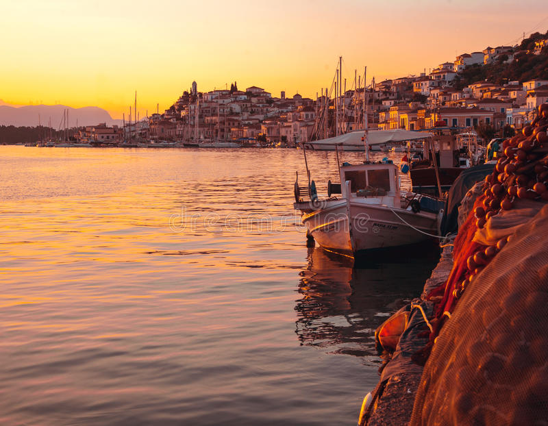 Landscape of a city, boat and sea at the sunset stock photos