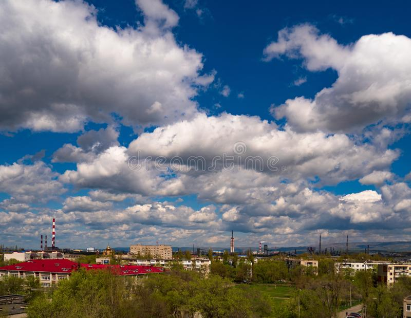 Landscape city building clouds furry sky blue industrial city school dome temple houses houses trees spring... royalty free stock photography