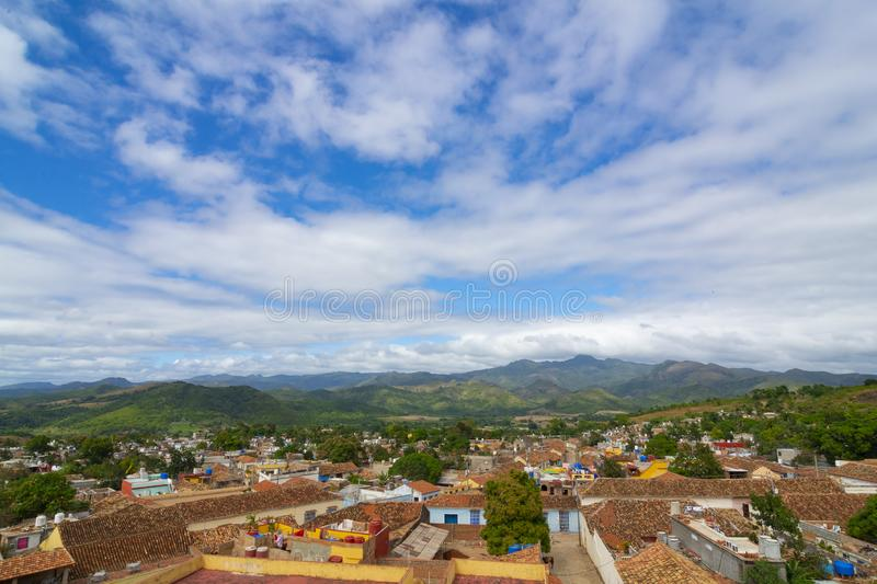 Landscape of city and mountains full of palm trees and flowers, under cloudy sky, sunny beautiful day, Trinidad, Cuba.  stock image