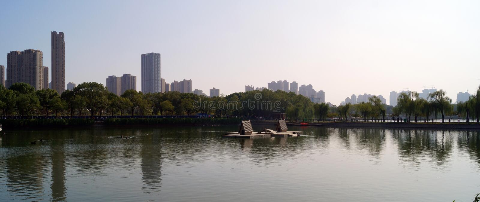 Panoramic view of Wuhan China. Landscape of the city of wuhan in China, view from the zoo near the city, bunch of plants and trees growing at the shore and big royalty free stock photos