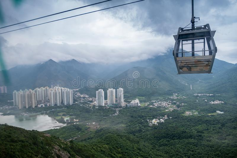 Landscape, cityscape, rainy day, The Building located on the seaside and surrounded by mountains. There is a cable car. Located on the right-hand side of the stock photography