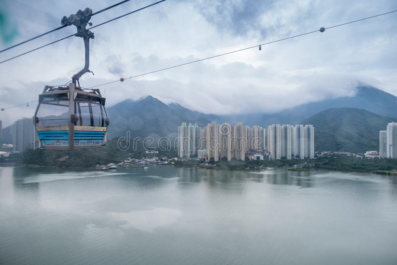 Landscape, cityscape, rainy day, The Building located on the seaside. There are mountains behind the building and a cable car royalty free stock photography
