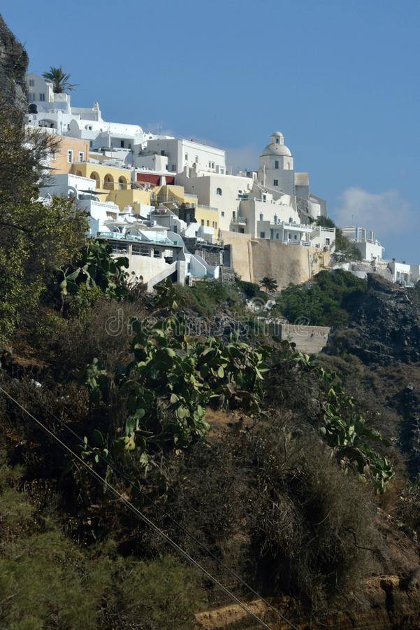 landscape and cityscape with typical greek architecture surrounded by wild nature stock image